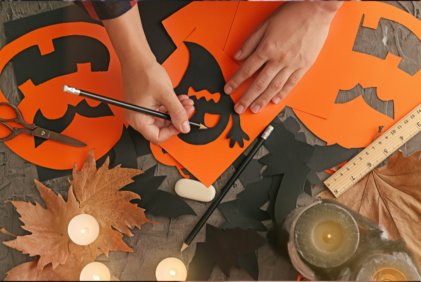 Halloween Crafts - tracing black ghost onto orange paper