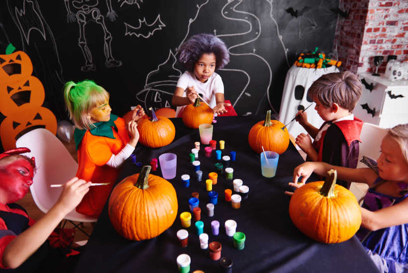 Kids painting pumpkins