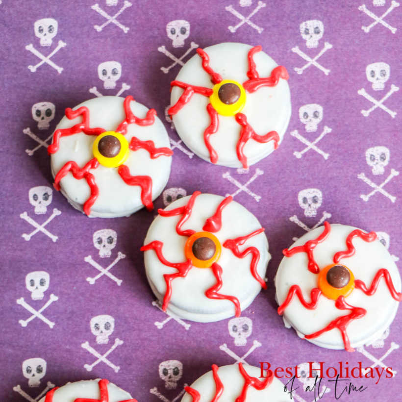 Four Oreo Halloween Eyeballs Cookies on Skull Background