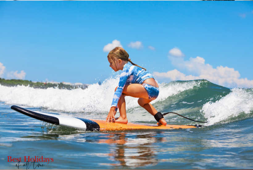 Kid learning Surfing Lessons