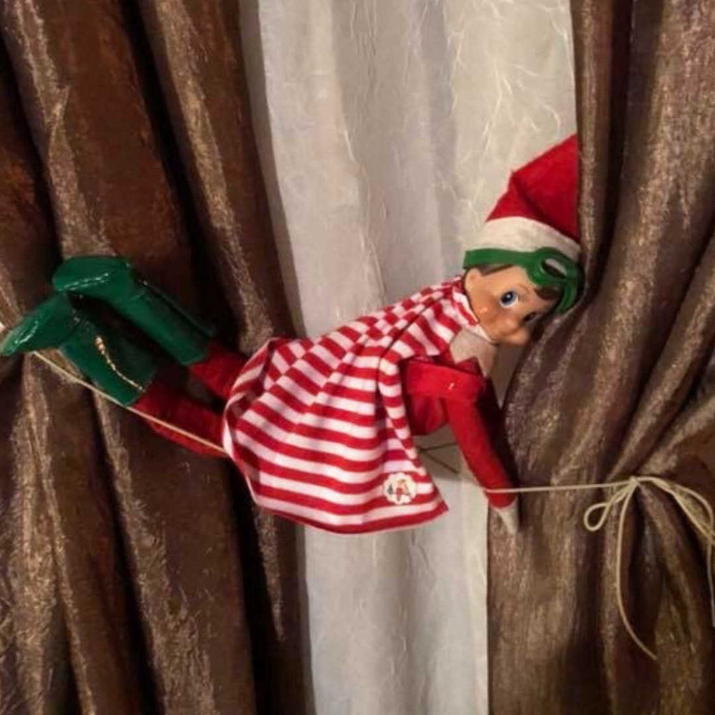 "elf on the shelf clothes - elf in super hero costume ""flying"" in the air"