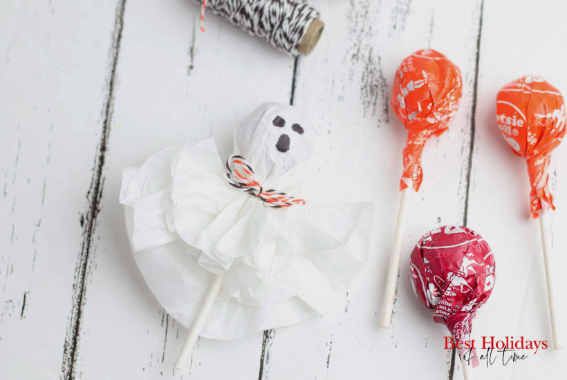 Ghost Lollipop with 3 other tootsie rolls on the right side of the picture