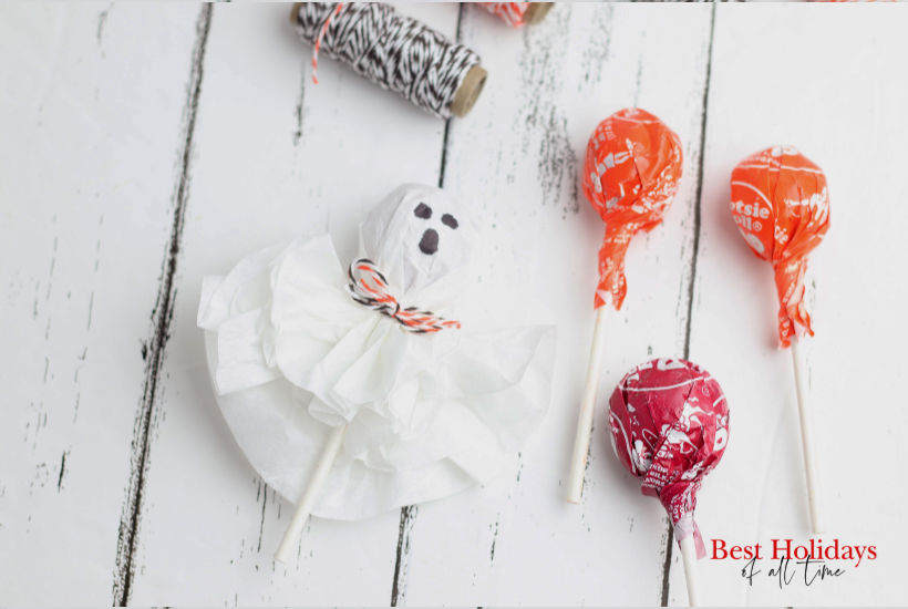 complete ghost lollipop with three tootsie roll pops to the right